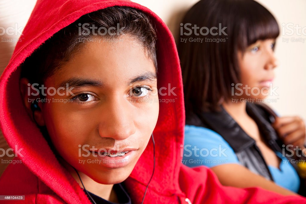 Pre-teen, mixed-race boy and African descent girl at school. stock photo