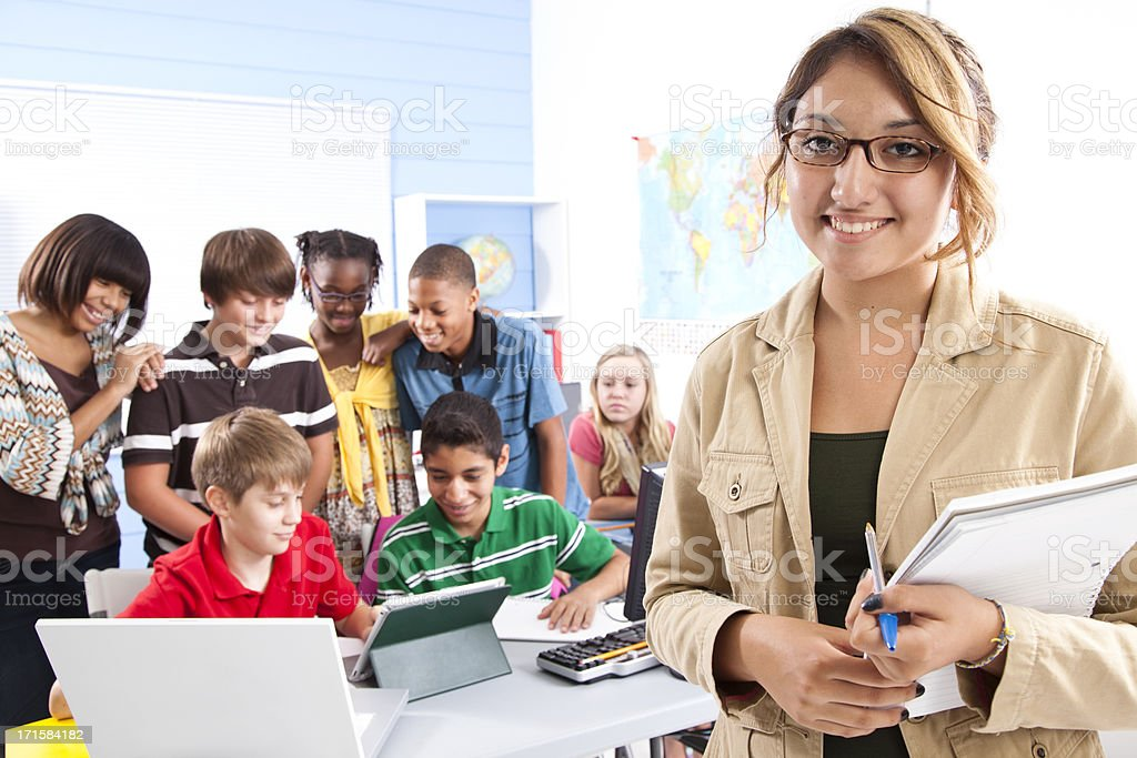 Pre-teen students in computer lab with instructor, teacher. School. Education. stock photo