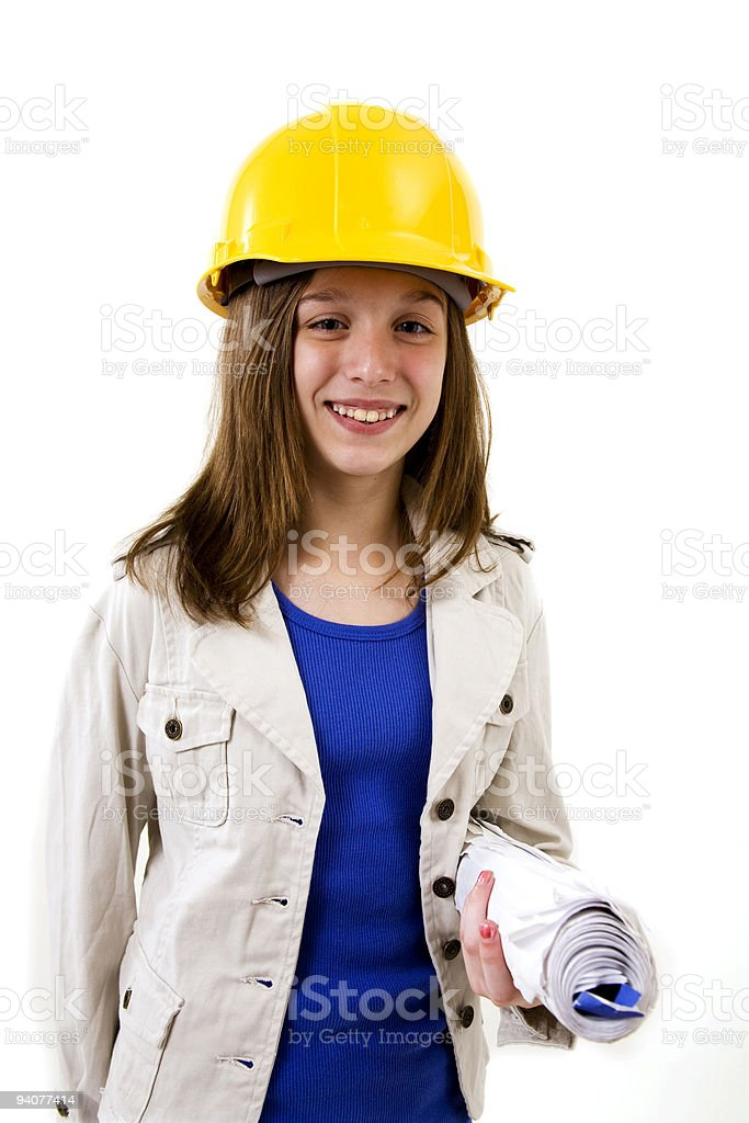 Pre-teen with hardhat and blueprints. royalty-free stock photo
