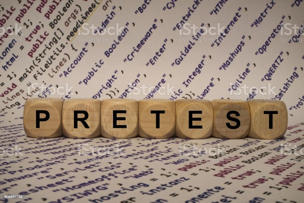 pretest - cube with letters and words from the computer, software, internet categories, wooden cubes stock photo