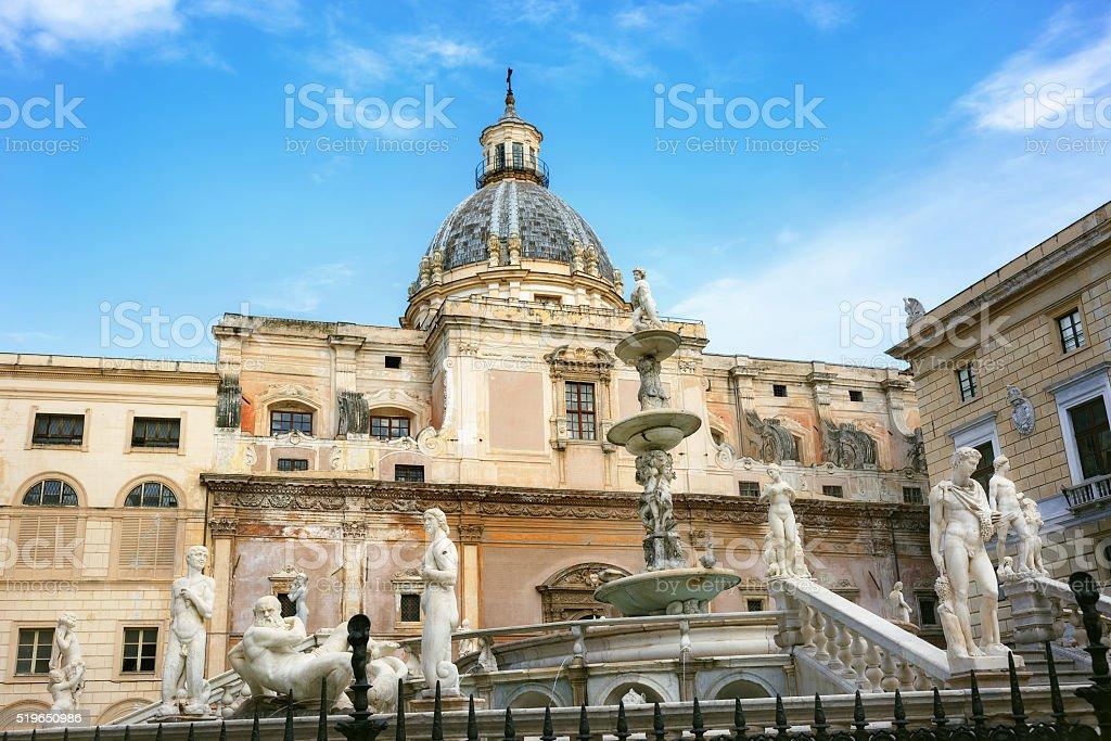 Pretoria Fountain with dome of church in Palermo, Sicily, stock photo