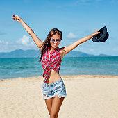 Pretti girl posing on the beach in summertime