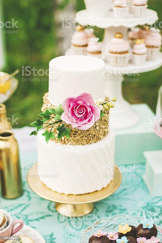 Prettiest wedding cake on dessert table stock photo