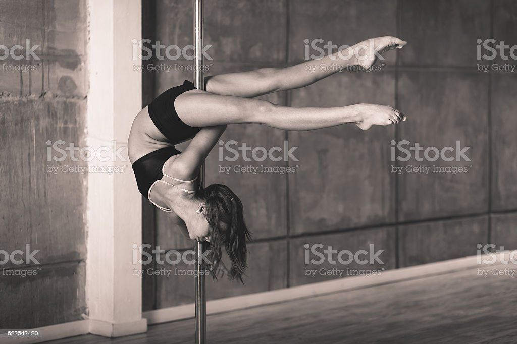 Pretty acrobat girl working out in the studio stock photo