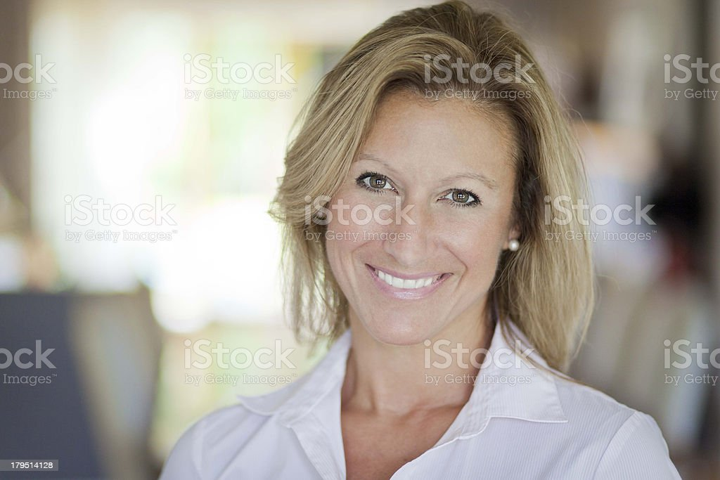 Pretty adult woman smiling stock photo