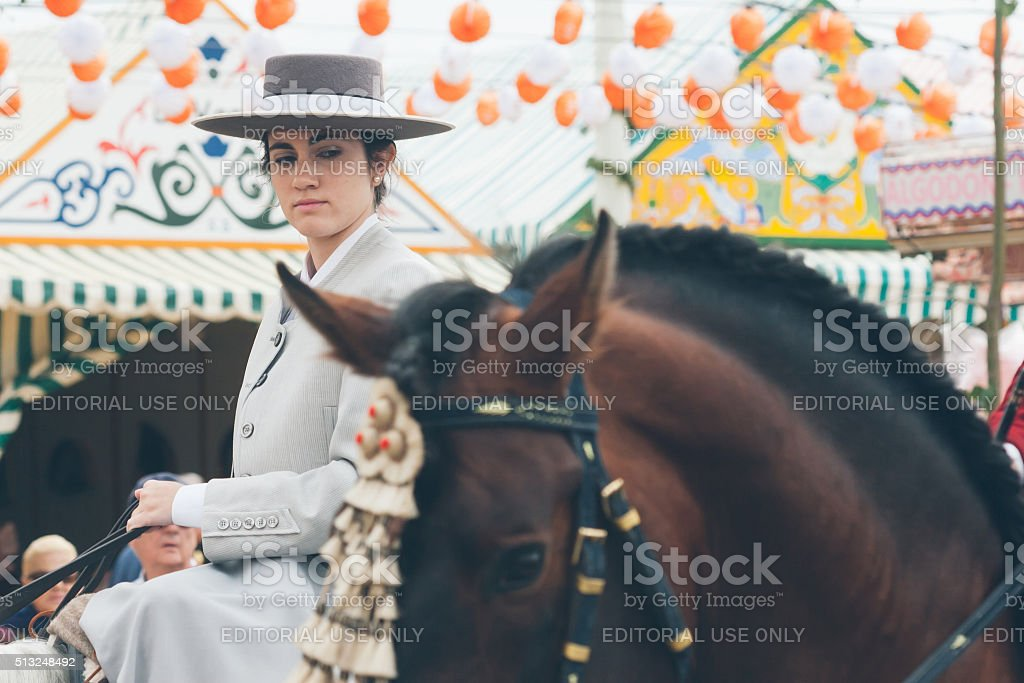 Pretty amazons wearing traditional Andalusian uniforms. Fair of Seville stock photo