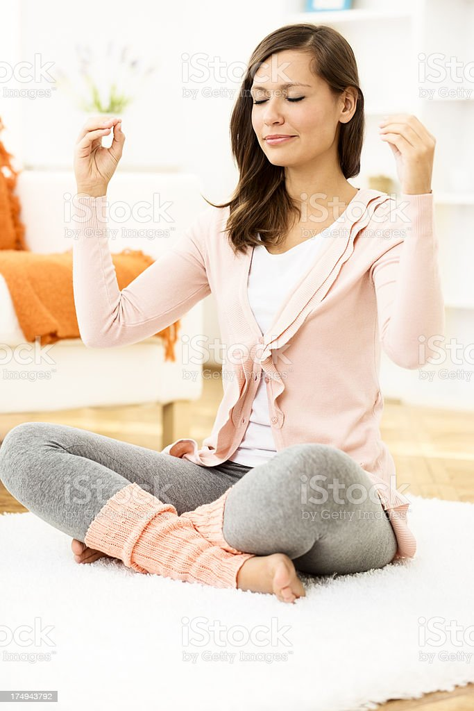 Pretty and young woman meditating royalty-free stock photo