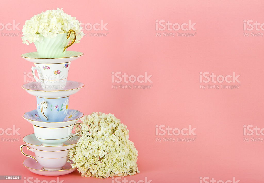 Pretty Antique Teacups On Pink stock photo