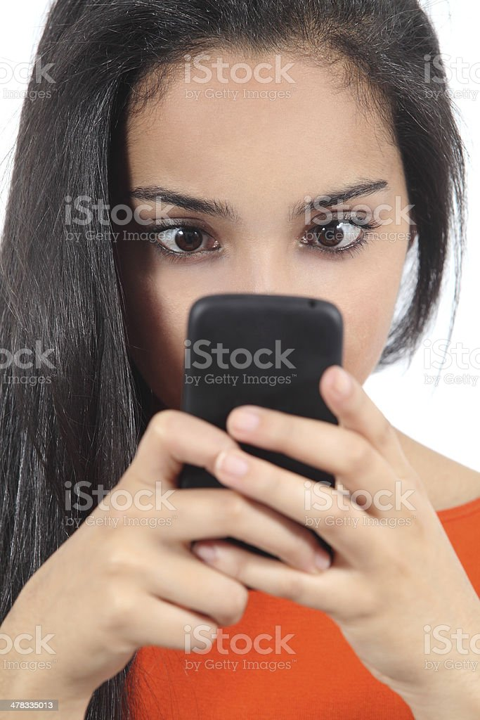 Pretty arab woman obsessed with her smartphone royalty-free stock photo