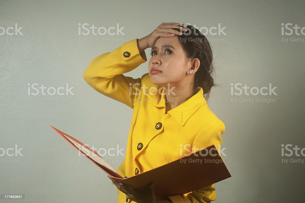 Pretty Asian businesswoman shocked and surprised. royalty-free stock photo
