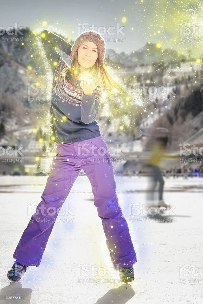 Pretty asian girl ice skating outdoor at ice rink stock photo