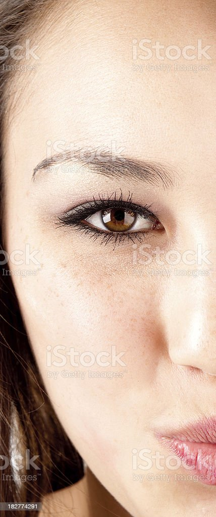 Pretty asian woman half face royalty-free stock photo