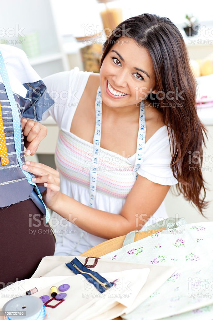 Pretty asian woman sewing at home royalty-free stock photo