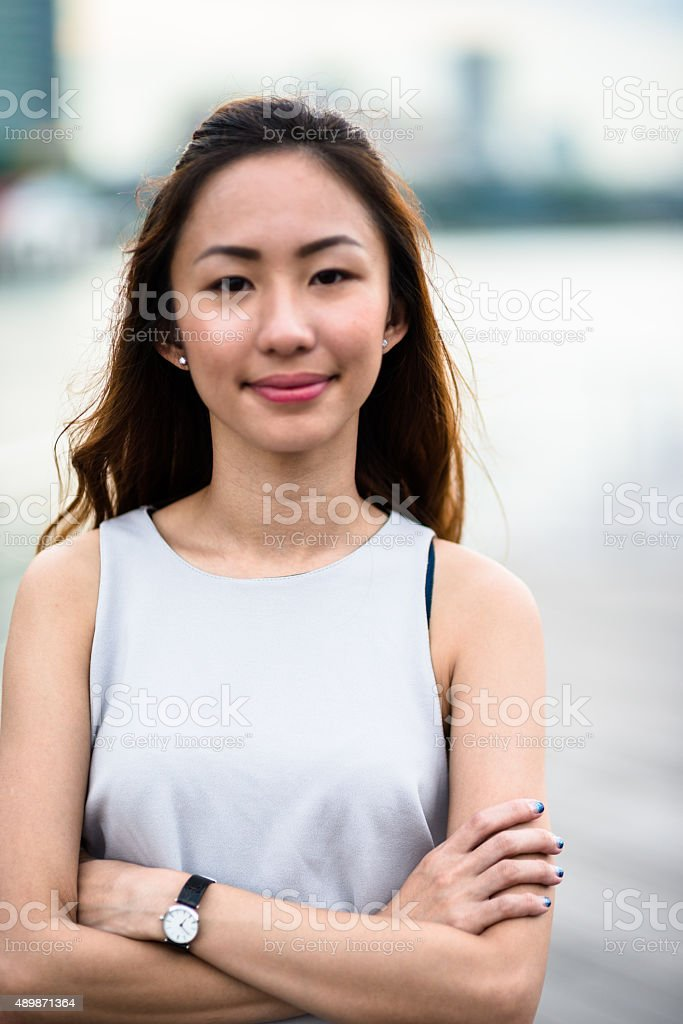pretty asian woman standing outdoors stock photo