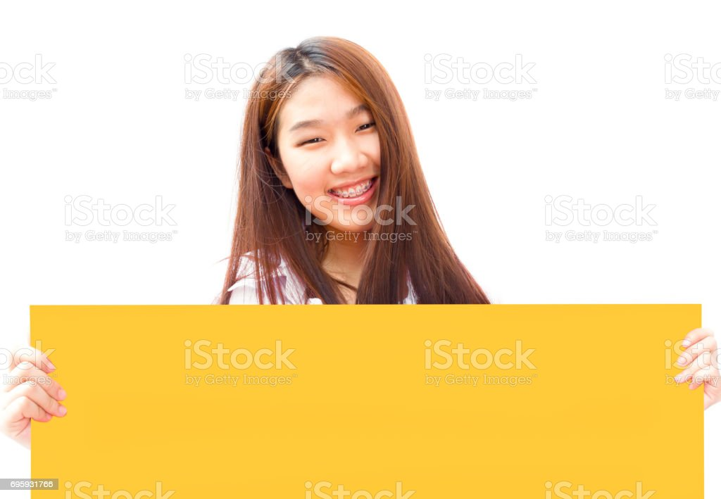 Pretty Asian young business woman holding a yellow billboard on white background stock photo