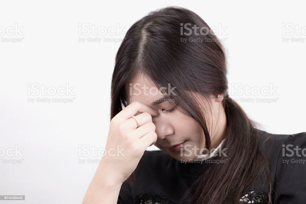 Pretty Asian young business woman with headache. stock photo