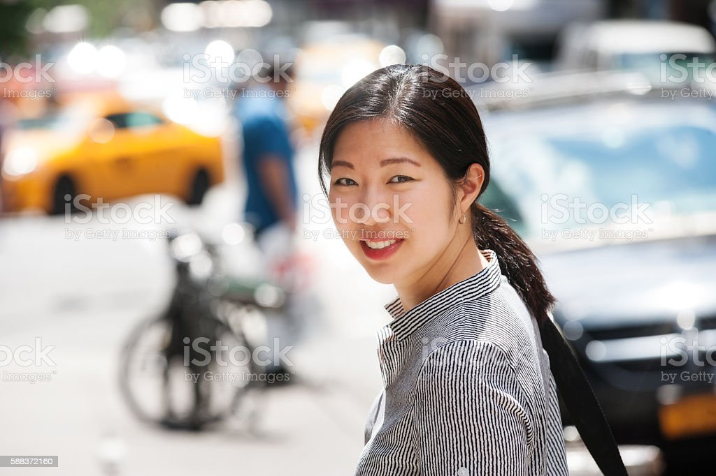 Pretty Asian young woman outdoors in City stock photo