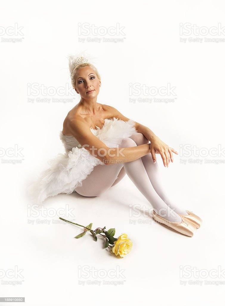 Pretty ballerina sitting with a rose. royalty-free stock photo