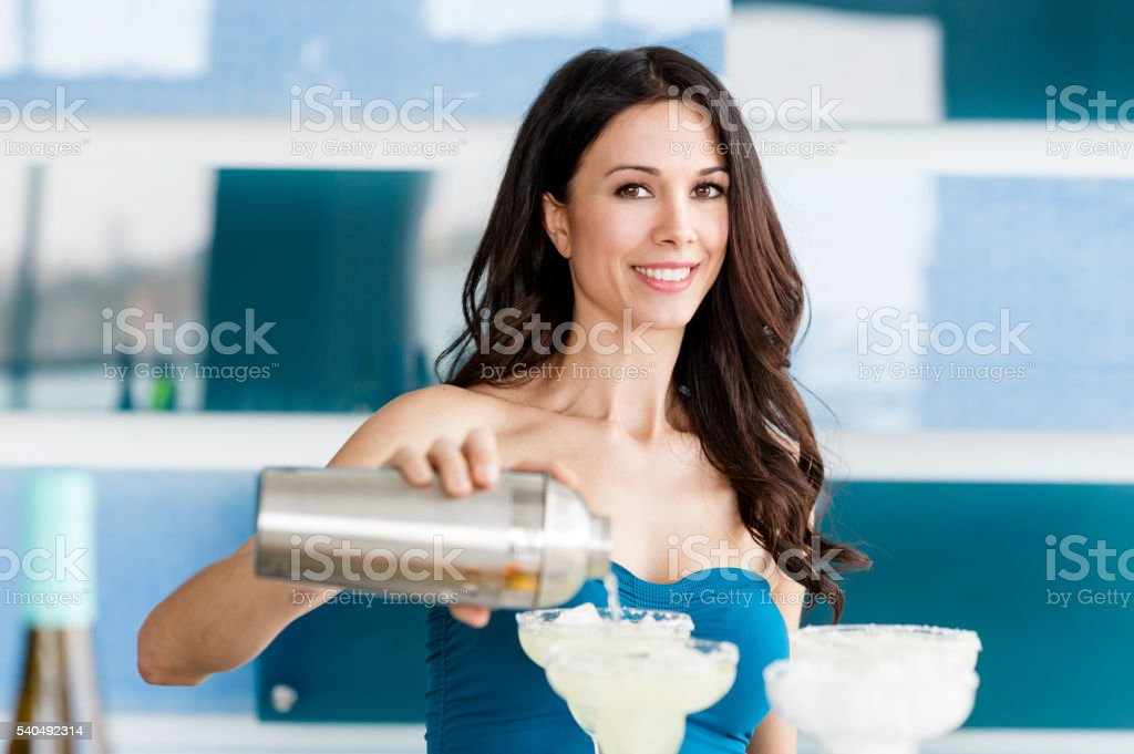 Pretty bartender making margaritas stock photo