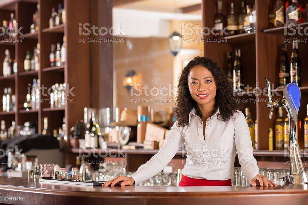 Pretty bartender stock photo