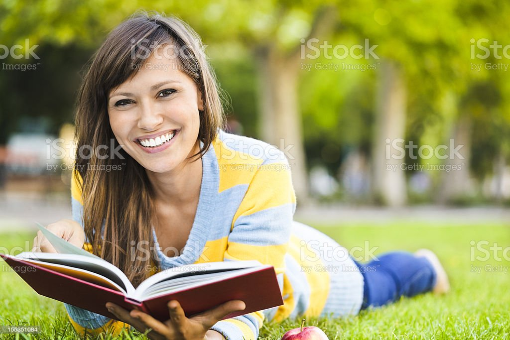 Pretty beauty reading a book royalty-free stock photo