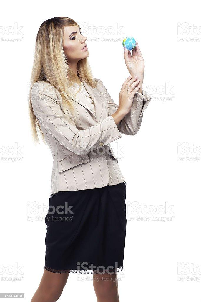 Pretty blond Business woman holding a world globe royalty-free stock photo