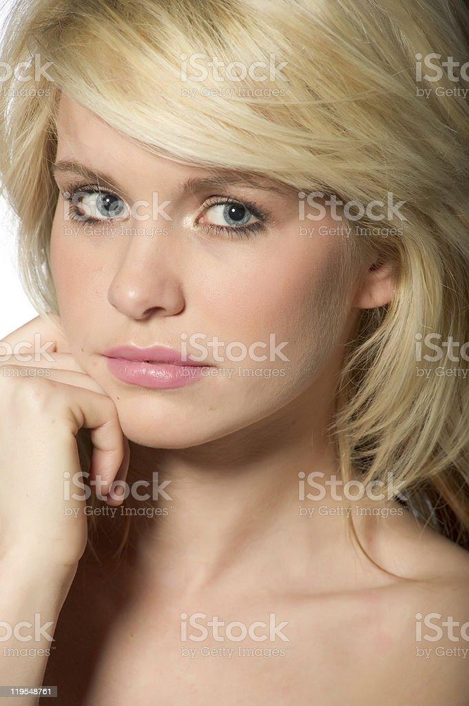 Pretty blond Caucasian woman - thinking, thoughtful stock photo