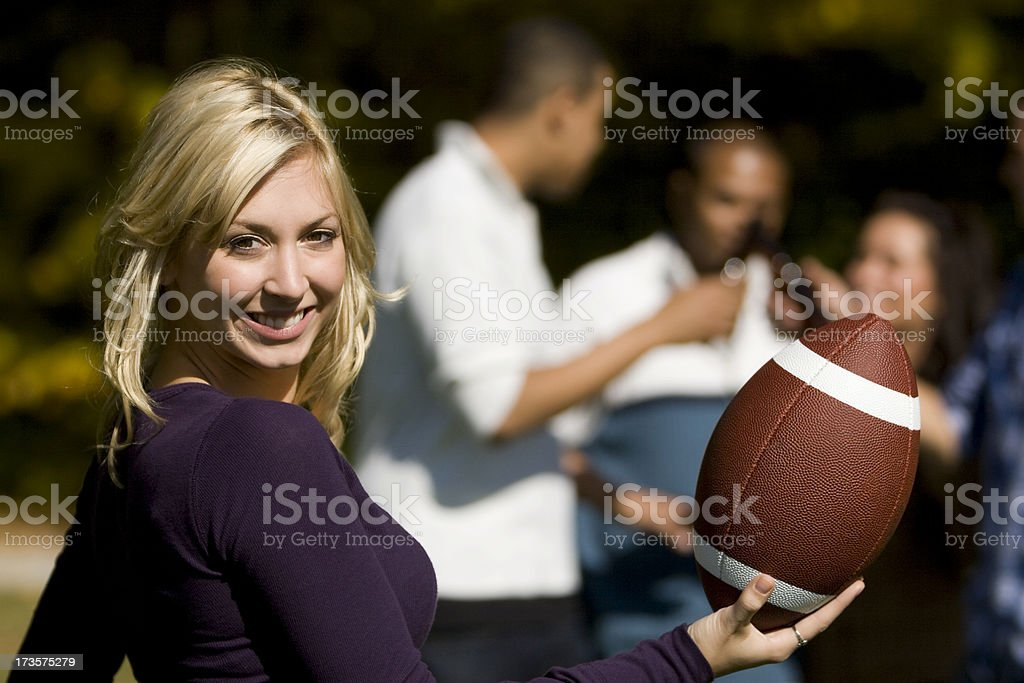 Pretty Blond Co-ed With Football royalty-free stock photo