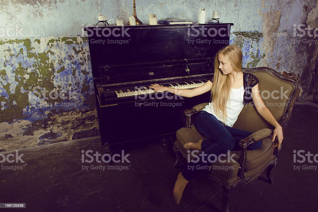 pretty blond girl at piano royalty-free stock photo