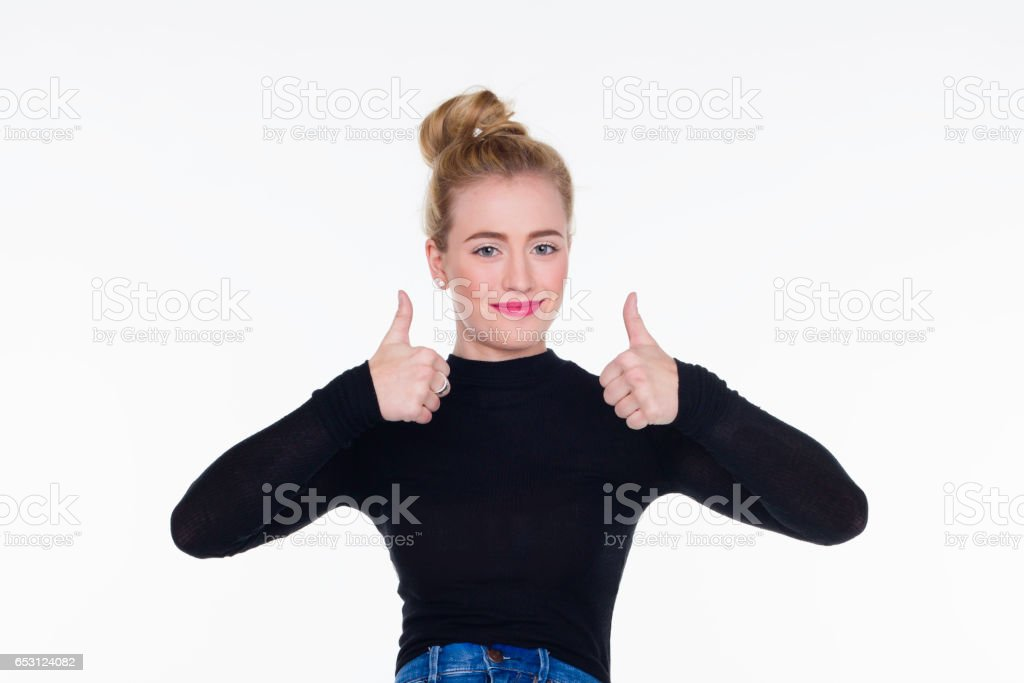 Pretty blond girl giving two thumbs up sign stock photo