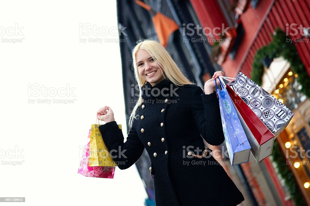 Pretty blond girl with shopping bags stock photo