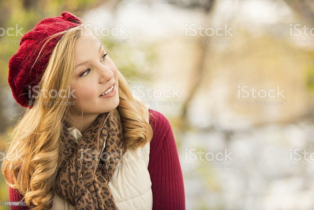 Pretty Blond Woman Looking to the Side Outdoors in Autumn royalty-free stock photo