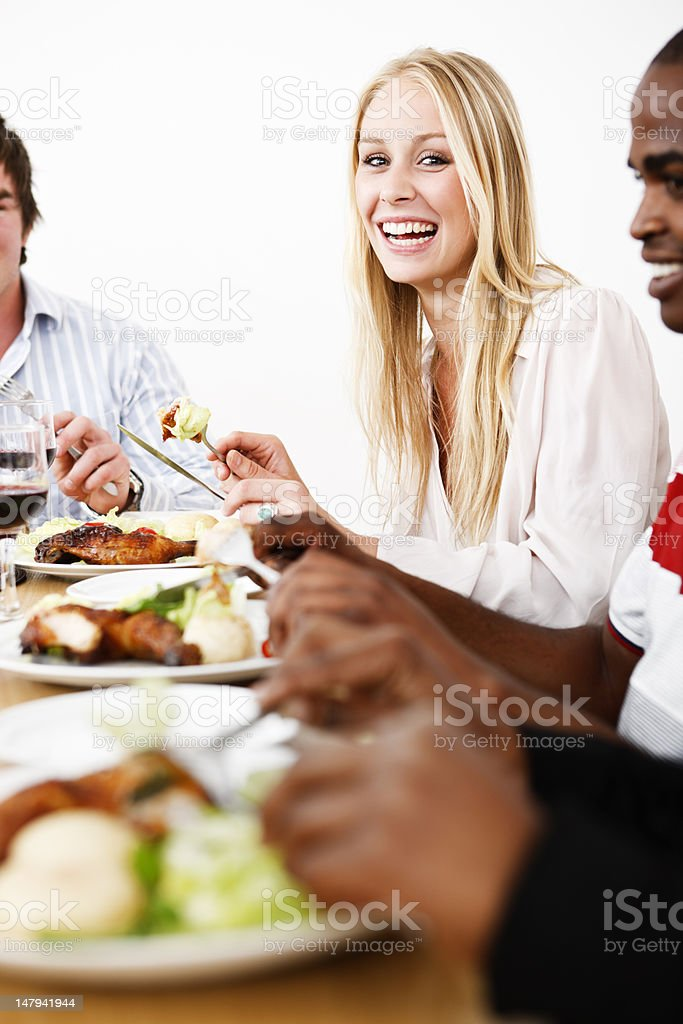Pretty blonde and friends round dining table stock photo