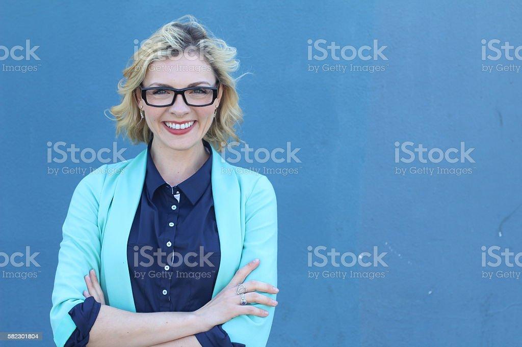 Pretty blonde designer smiling at camera stock photo