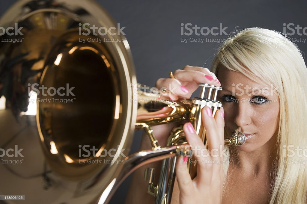 Pretty blonde female trumpet player royalty-free stock photo