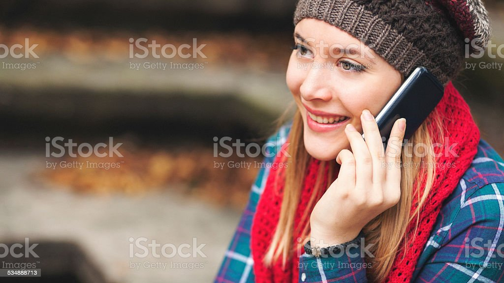 Pretty blonde girl talking on mobile phone stock photo