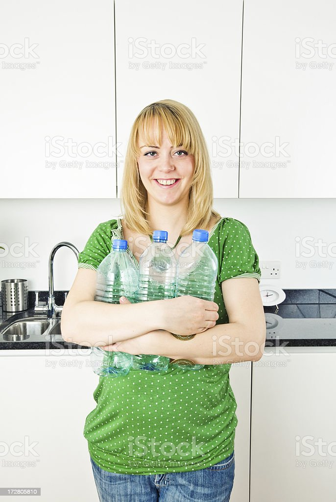 Pretty blonde in the kitchen royalty-free stock photo