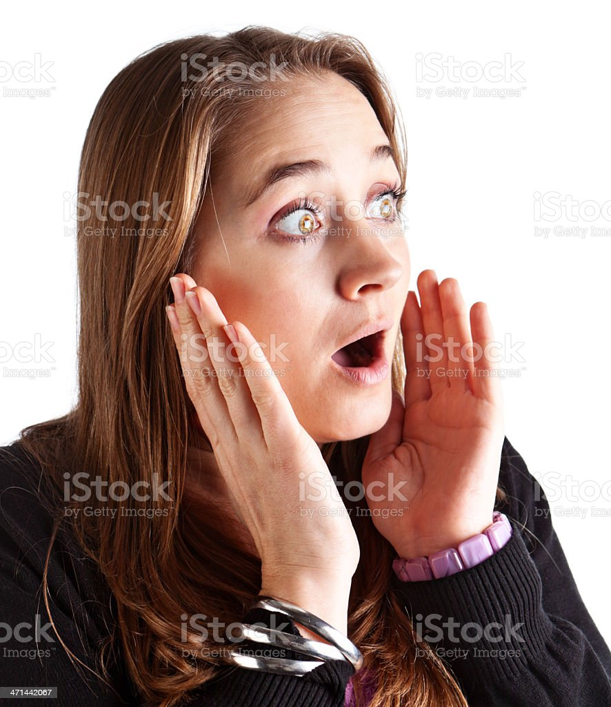 Pretty blonde is shocked or frightened by something unseen stock photo