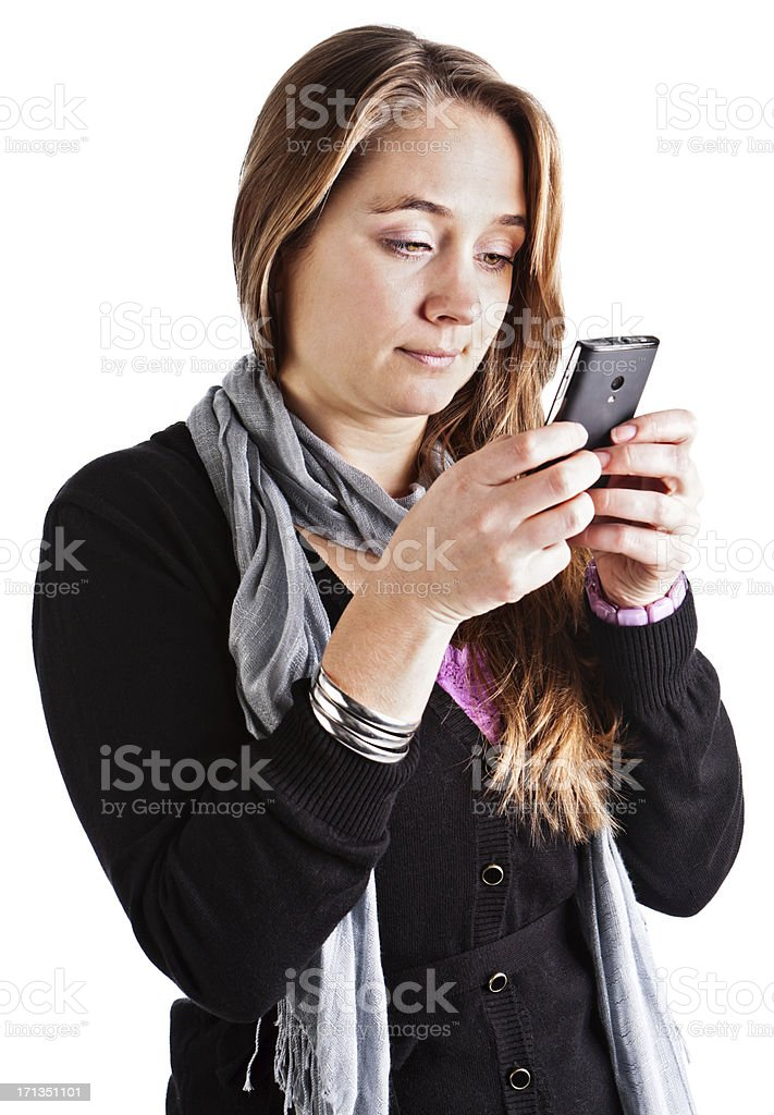 Pretty blonde looks down, concentrating on her texting stock photo