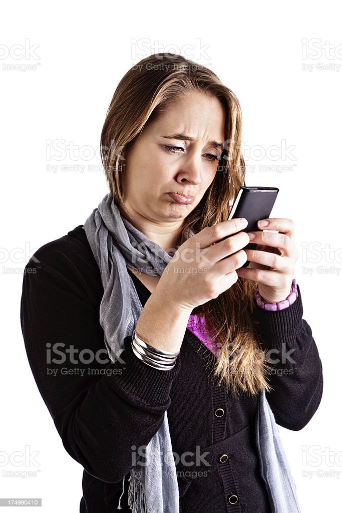 Pretty blonde pouts at ugly message or image on phone stock photo