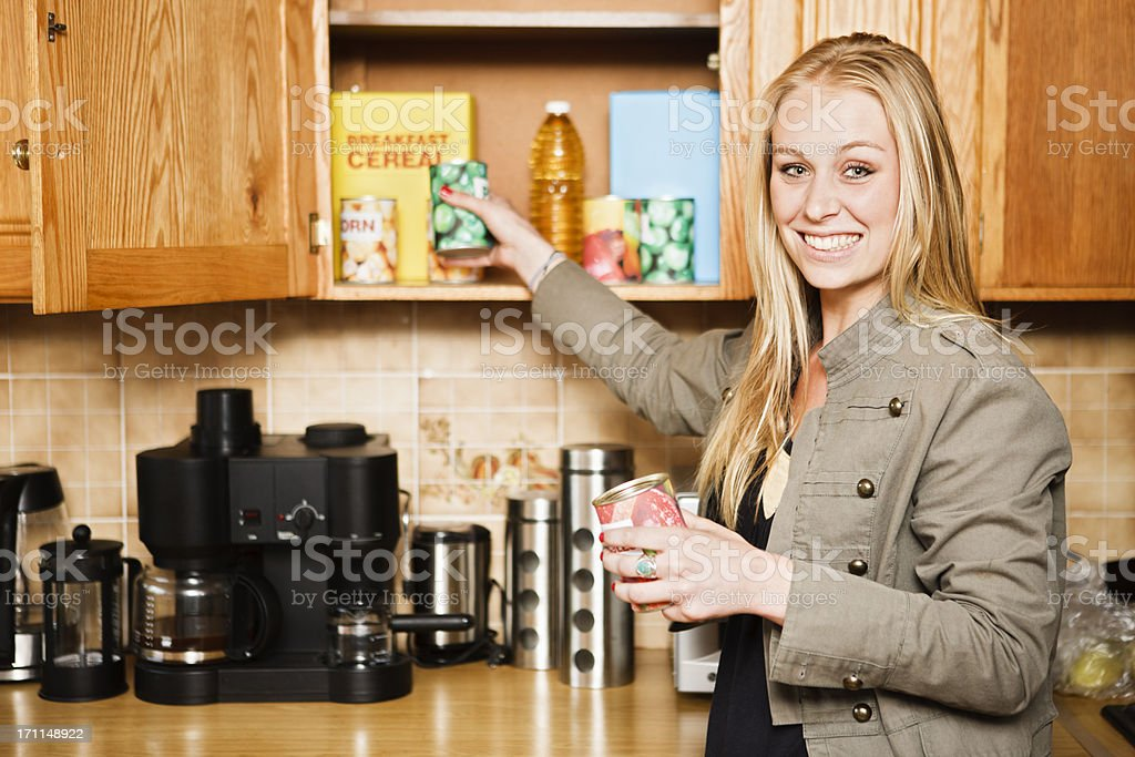 Pretty blonde reaches for food stock photo