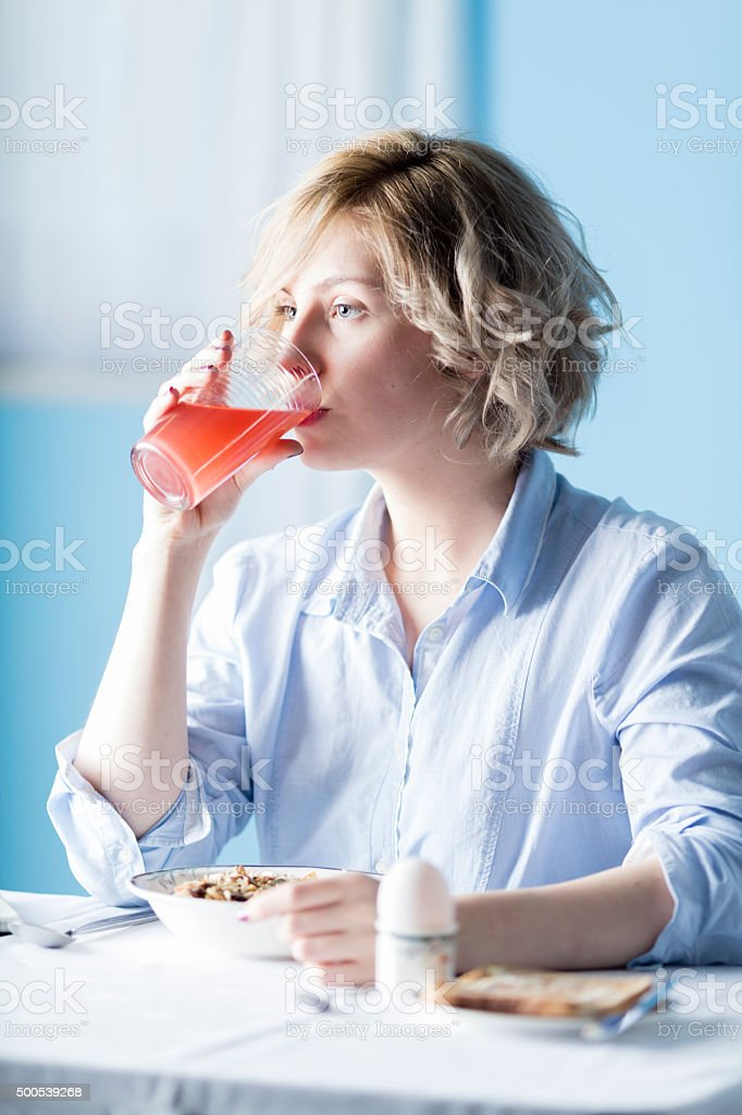 Pretty Blonde Teenager At Breakfast-time stock photo