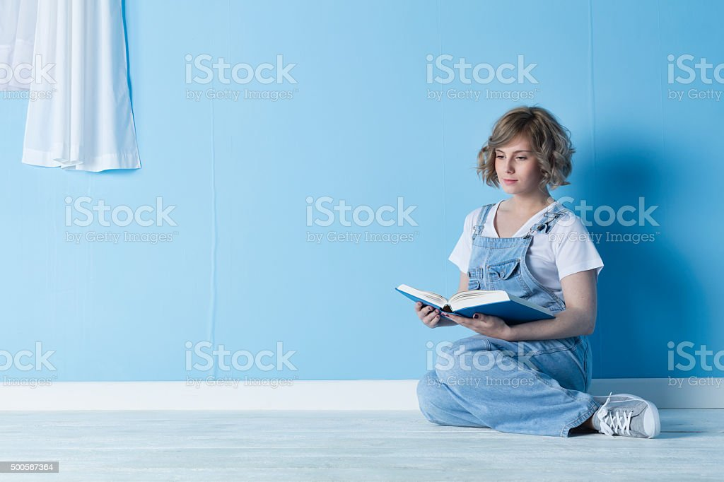 Pretty Blonde Teenager Reading A Book stock photo