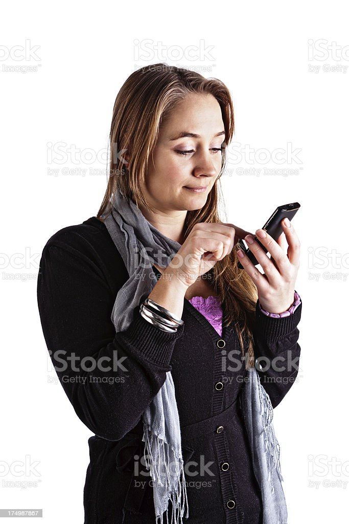 Pretty blonde texting on smart phone looks down, smiling gently stock photo