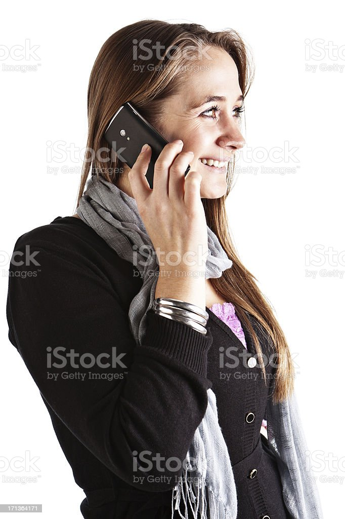 Pretty blonde woman chats on mobile phone, smiling stock photo