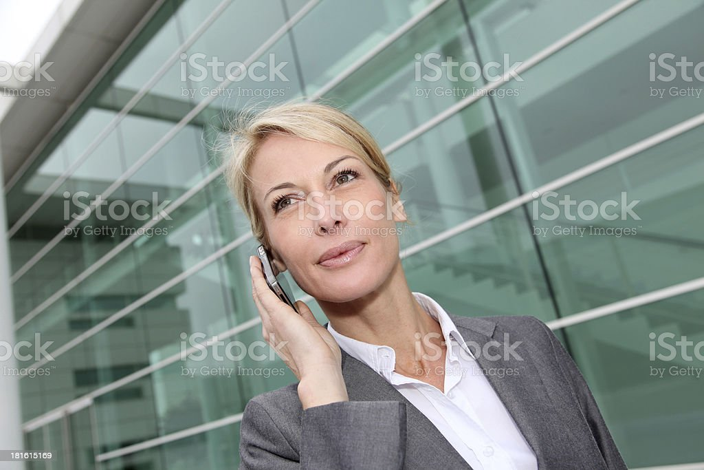 Pretty blonde woman talking on mobil phone outdoor royalty-free stock photo
