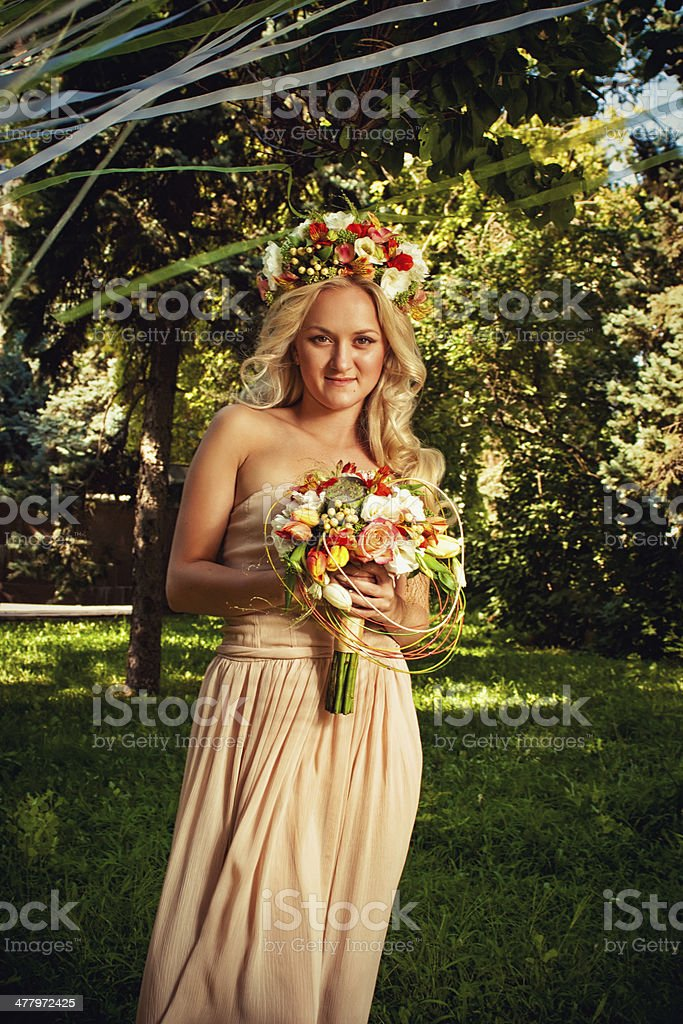 Pretty bride with flowers royalty-free stock photo