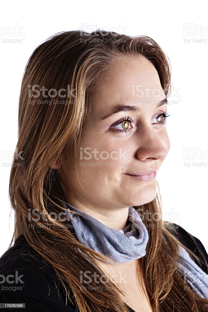 Pretty, brown-eyed blonde looks to side, smiling stock photo