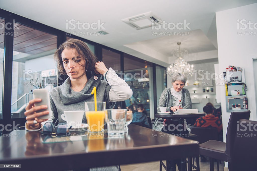 Pretty Brunette at the Coffee Bar Caffe Trieste, Europe stock photo
