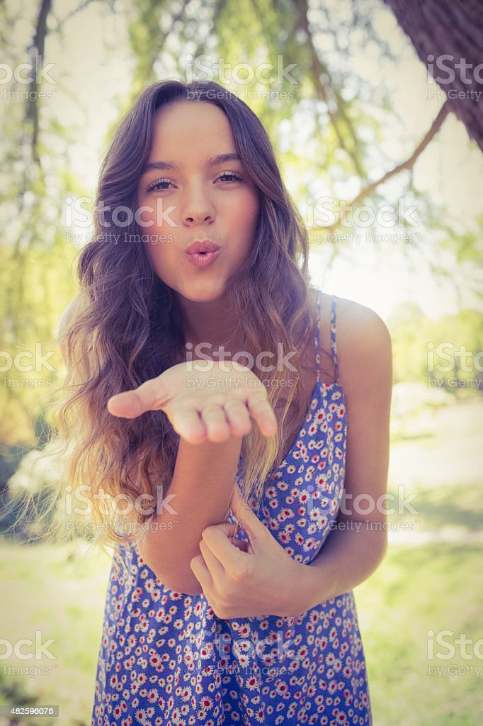 Pretty brunette blowing kiss at camera stock photo